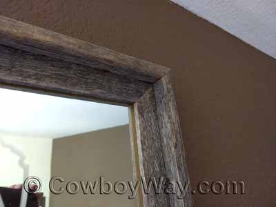 A barn wood frame holding a mirror