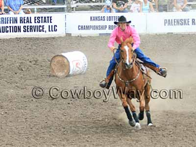 A barrel racer knocks down the first barrel