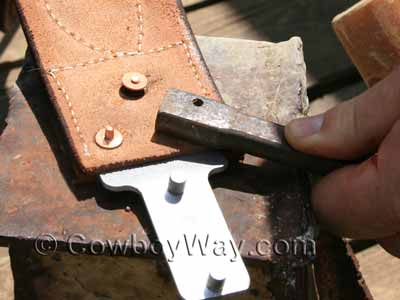 Using the copper rivet and burr setter tool to drive the burrs down to the bottom of the posts