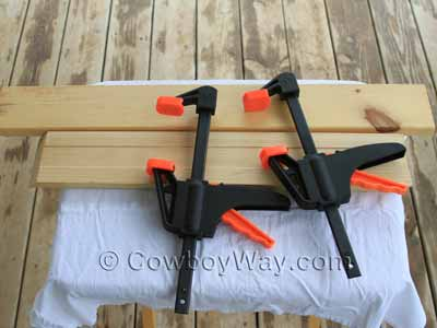Two boards and two C clamps