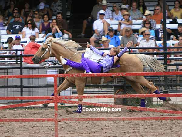 A trick rider on the racetrack at The Cheyenne Frontier Days Rodeo