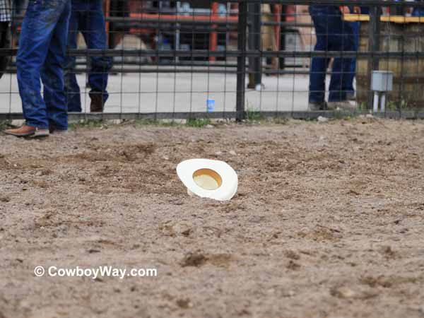 A cowboy hat in the dirt