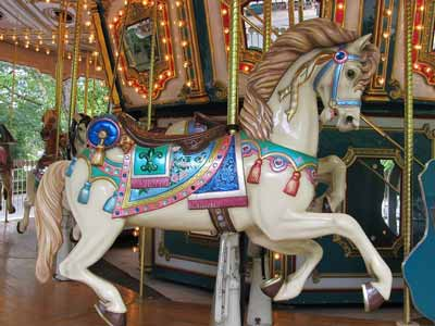 A full size wooden carousel horse