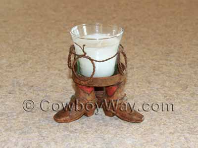 A small cowboy candle holder