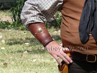Cowboy cuffs with brass accents