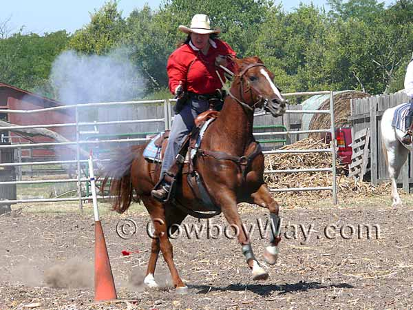 Both men and women compete in Cowboy Mounted Shooting