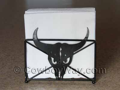 A napkin holder with a steer head design.