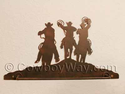 Cowboys on a towel rack