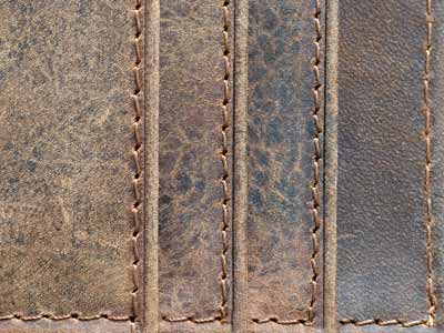Four leather/cowhide placemats