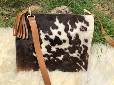 A beautiful, simply styled, cowhide purse