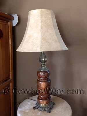 Faux leather lamp shade on a wooden, hand-lathed lamp