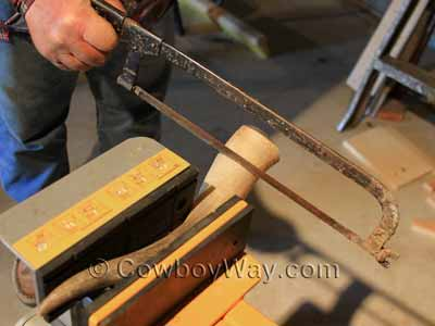Sawing off the base of the horn
