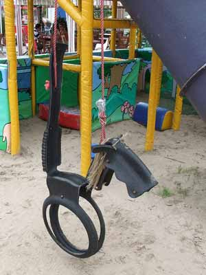 A horse tire swing in a playground