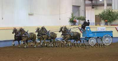 A six horse team pulling a horse drawn wagon