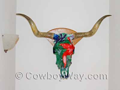 A cow skull that has been painted by hydro dipping