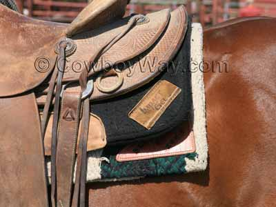 An Impact Gel saddle pad on a ranch horse