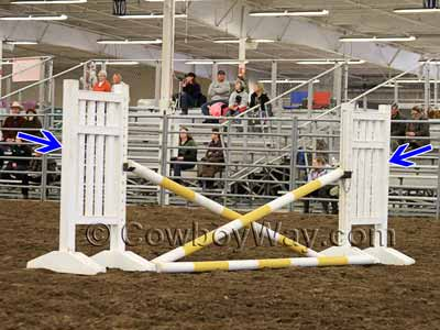 Jump standards with a cross rail schooling jump