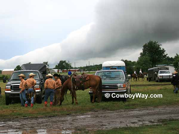 Heavy rain clouds over a women's ranch rodeo