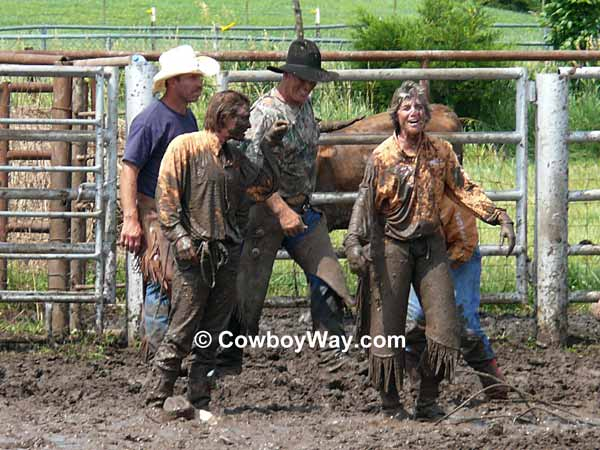 Cowgirls covered in mud