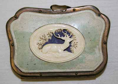 A small cowhide purse with a deer design