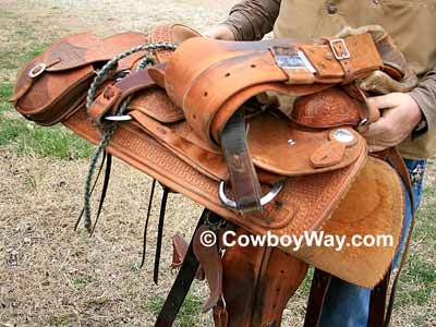 Lay the cinches, etc. across the saddle seat