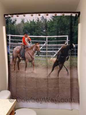 A shower curtain with a Western theme