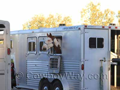 A horse trailer without a window screen