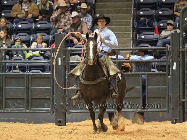 Troy Higgs waits on his horse to rope his team's cow