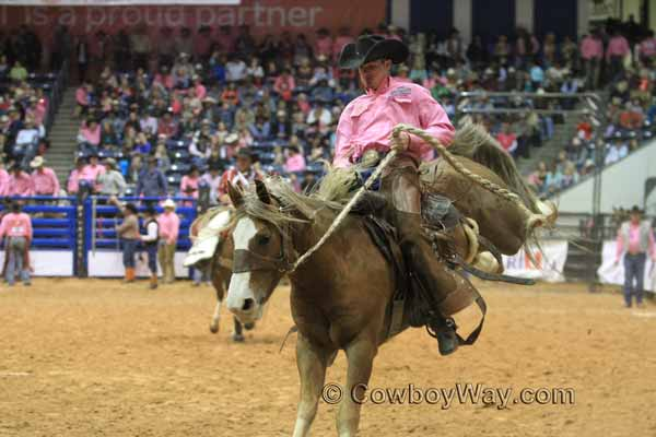 WRCA Ranch Bronc Riding 2014 - Bronc Rider Chaz Brewer on a sorrel bronc