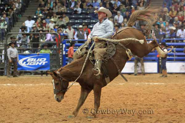 Bruce Beeman, Kansas, rides a ranch bronc at the WCRR in Amarillo, TX