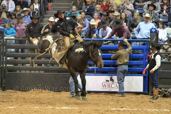 Jake Mitchell from the Crutch Ranch in Texas on rides a ranch bronc
