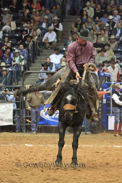 Jeremiah Campbell from the Davison and Sons Cattle Co., Oklahoma, in the ranch bronc riding event