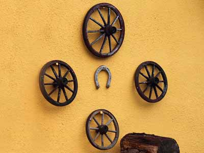 Wagon wheels hung on a wall as decor