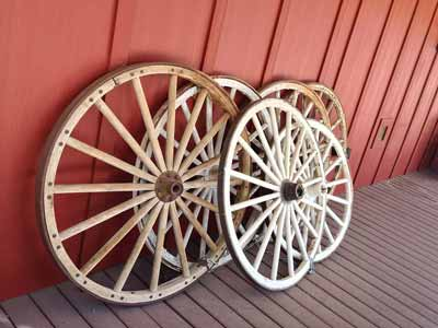 Wagon wheels leaning on a wall