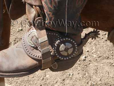 Western spurs on a working cowboy