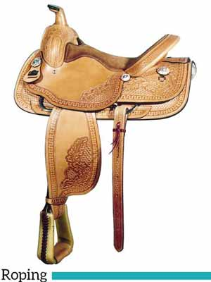 A lightweight floral tooled roping saddle by Big Horn. Weighs approximately 35 pounds.