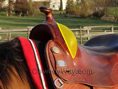 A trail riding saddle with an illustration removing much of the fork